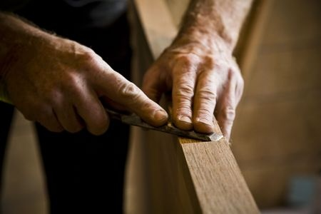 Man's hands using carpentry tool