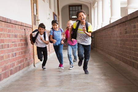 School children running down hall