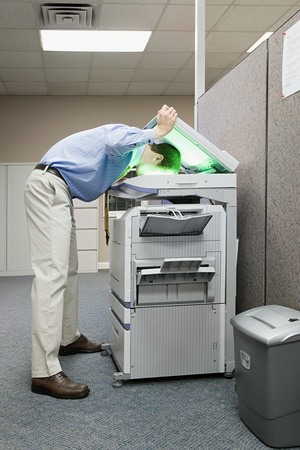 HGR summer intern photocopying head