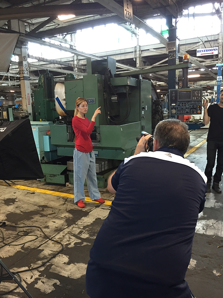 RPM photo shoot of woman wearing safety glasses at HGR Industrial Surplus