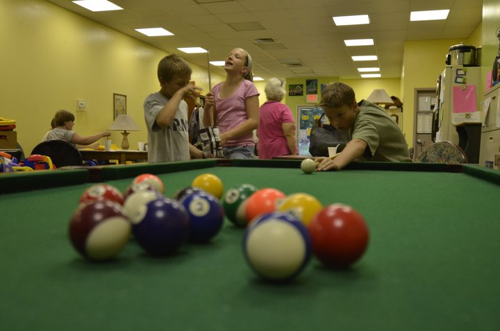 Kids playing pool at The Lodi Family Center