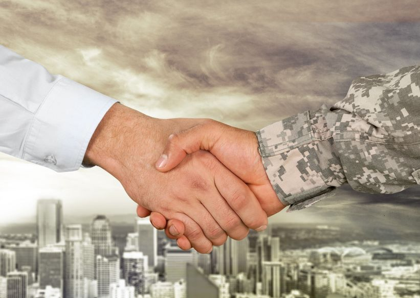 veteran shaking hands with employer