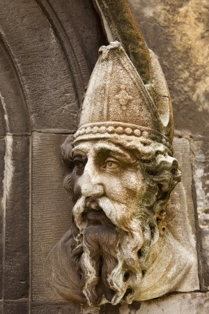 a stone carving of saint patrick on the lower door to the chapel royal of dublin castle in dublin, ireland