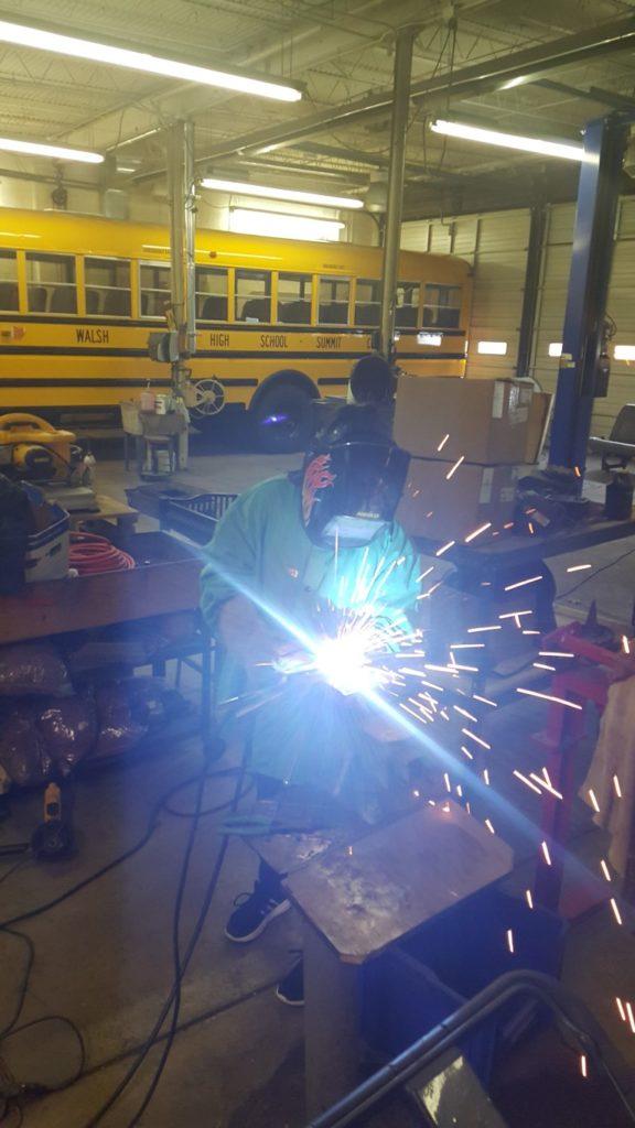 Brenna Truax welding