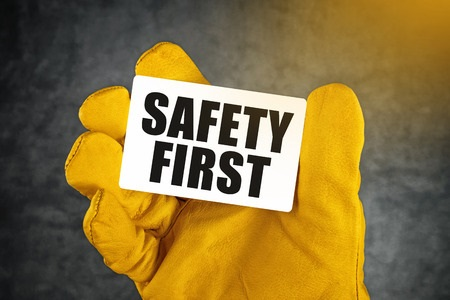 safety first card in gloved hand