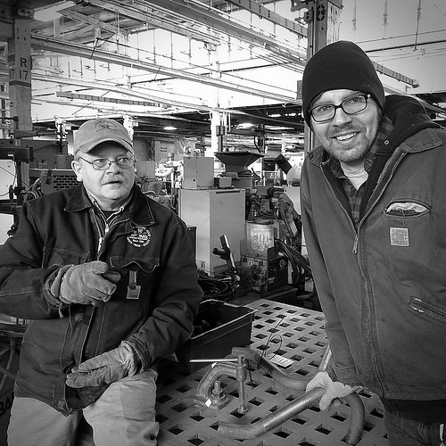 OWWM Bill and James looking at a welding table at HGR Industrial Surplus